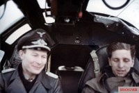 "Bomber ace Major Werner Baumbach (left, Gruppenkommandeur III.Gruppe / Kampfgeschwader 30 ""Adler"") as a ""Fluggast"" inside the cockpit of a Heinkel He 111."