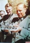 """SS-Brigadeführer und Generalmajor der Waffen-SS Fritz Witt (27 May 1908 – 14 June 1944), commander of 12. SS-Panzer-Division """"Hitlerjugend"""", receives a model of an 8-wheel armoured scout car Sd.Kfz.232."""