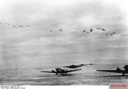 Ju 52s at Korsun airfield, Ju 87s in formation above, January 1944.