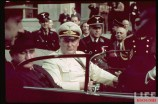 """French Prime Minister Edouard Daladier and German Generalfeldmarschall Hermann Göring (Oberbefehlshaber der Luftwaffe) in an open-top sedan in Münich, Germany, 29 September 1938, during the conference for a settlement permitting Nazi Germany's annexation of portions of Czechoslovakia along the country's borders mainly inhabited by German speakers, for which a new territorial designation """"Sudetenland"""" was coined. SS officer standing behind Göring is SS-Hauptsturmführer Peter Hogl."""