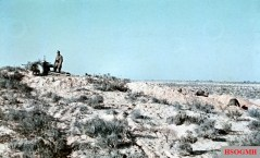German anti-tank crew with his camouflaged gun in the desert of Qattara depression. Photo taken by General Erwin Rommel during his Campaign in North Africa, 1941.
