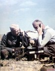 Two German officers using Feldtelefon (field telephone) at a position near Stalingrad, Autumn 1942. From left to right: Oberst Moritz von Drebber (Kommandeur Infanterie-Regiment 523 / 297.Infanterie-Division) and Hauptmann Bender.