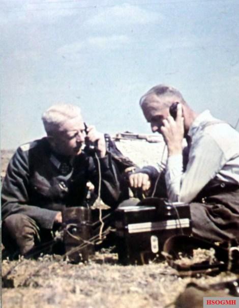 Two German officers using Feldtelefon (field telephone) at a position near Stalingrad, Autumn 1942. From left to right: Oberst Moritz von Drebber (Kommandeur Infanterie-Regiment 523 / 297.Infanterie-Division) and Hauptmann Bender.