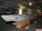 Submarine No.105 with a torpedo mounted at the Royal Navy Submarine Museum.