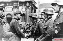 Léon Degrelle, leader of Rex and member of the Walloon Legion, pictured in Charleroi in April 1944. Degrelle saw the Legion as a political tool to gain German support with Sepp Dietrich in the background.