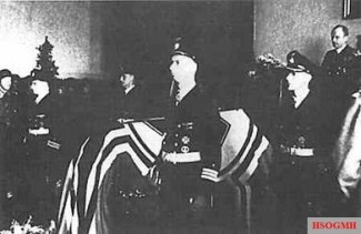 Wolfgang Lüth's state funeral, Grand Admiral Karl Dönitz is on the far right delivering the eulogy.