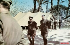 "Two prominent German generals in North African theatre takes a little walk while discussing the recent situation: Generalfeldmarschall Erwin Rommel (Oberbefehlshaber Panzerarmee ""Afrika"") and General der Panzertruppe Ludwig Crüwell (Kommandierender General Deutsche Afrikakorps)."