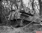 A Tiger I of the 503rd battalion overturned at Manneville by the bombing during Operation Goodwood.