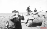 Adelbert Schulz, commander of 25 Panzer Regiment, the main striking force of the 7th Panzer Division, near a Panzer III in June 1943.