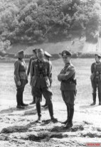 General Erwin Rommel and staff observe 7th Panzer Division practicing a river crossing at the Mosel, 1940.