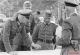 Fedor von Bock (left), Hermann Hoth (center), Walther von Hünersdorff (back side), and Richthofen (right, back turned), 8 July 1941. This photo was taken during the battles of Smolensk.