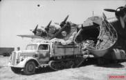 Opel Maultier towing an artillery piece onto or off an Me-323.