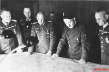 Halder on the far right studying a map alongside Hitler, 1940.
