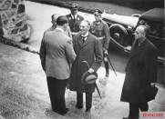 Adolf Hitler greets British Prime Minister Neville Chamberlain on the steps of the Berghof.