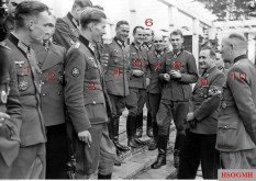 In 3 November 1942, a big delegation of Ritterkreuzträger (German Knight's Cross recipients) visited the Reichsjugendführung, doing inspections of training places and communications with young Hitlerjugend members. This picture was taken when they met the HJ leader, Reichsjugendführer Artur Axmann. The identification as follow: 1.Hauptmann Karl Langesee (Kommandeur II.Bataillon / Jäger-Regiment 207 / 97.Jäger-Division. Ritterkreuz in 10 August 1942), 2.Leutnant der Reserve Gerhard Hein (Führer 5.Kompanie / II.Bataillon / Infanterie-Regiment 209 / 58.Infanterie-Division. Ritterkreuz in 3 September 1940 and Eichenlaub in 6 September 1942), 3.Hauptmann Harald von Hirschfeld (Führer II.Bataillon / Gebirgsjäger-Regiment 98 / 1.Gebirgs-Division. Ritterkreuz in 15 November 1941), 4.Hauptmann Erich Löffler (Kommandeur II.Bataillon / Infanterie-Regiment 57 / 9.Infanterie-Division. Ritterkreuz in 7 October 1942), 5.Oberleutnant Wilhelm Henz (Kommandeur 2.Kompanie / Kradschützen-Bataillon 29 / 29.Infanterie-Division. Ritterkreuz in 8 August 1941), 6.Oberleutnant der Reserve Günther Hilt (Führer 7.Kompanie / II.Bataillon / Jäger-Regiment 56 / 5.Jäger-Division. Ritterkreuz in 14 September 1942), 7.Hauptmann Max Sachsenheimer (Kommandeur II.Bataillon / Jäger-Regiment 75 / 5.Jäger-Division. Ritterkreuz in 5 April 1942), 8. Hauptmann Hans-Gotthard Pestke (Chef 3.Kompanie / I.Bataillon / Infanterie-Regiment 176 / 61.Infanterie-Division. Ritterkreuz in 15 November 1941), 9.Reichsjugendführer Artur Axmann, and Generalleutnant Friedrich Herrlein (General der Infanterie beim Oberkommando des Heeres. Ritterkreuz on 22 September 1941).