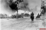 German soldiers on horseback in a burning village near Mogilev at the Dnieper. The Red Army has been driven out by German artillery fire.