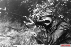 """Fallschirmjäger poses with his early model FG 42 (Ausführung """"C"""") in France, 1944."""