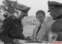 Scholtz-Klink center in conversation with Heinrich Himmler left, August/September 1943.