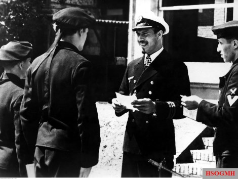 Kapitänleutnant Herbert Nau awarding the Eisernes Kreuzes (Iron Crosses) to the sailors of his ship, July 1944.