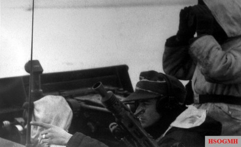 Joachim Peiper (foreground) in his command vehicle Sd.Kfz. 251 giving instruction outside Kharkov in February 1943. During this period the 320. Infanterie-Division was cut off by the Red Army with a wide gap of some 65km (40 miles) appeared between it and the Leibstandarte Division. A kampfgruppe under the command of SS-Sturmbannführer Joachim Peiper was formed and tasked with penetrating some 40km (25 miles) behind enemy lines, contacting the 320. Infanterie-Division, and guiding it back to the German lines. This was no small undertaking, but was one which Peiper accomplished with great success and remarkably little loss of life. For this achievement, Peiper was awarded the Knight's Cross. It was the first of many daredevil exploits which would be carried out by this remarkable soldier.