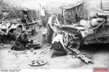 A German half-track is repaired near Vyazma.