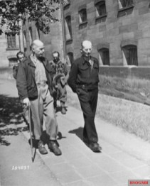 Wilhelm List (left) and Walter Kuntze (right) take a walk in the prison yard during the Hostage Case.