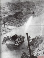 Sd.Kfz. 251-mounted Wurfrahmen in action against Polish positions during the Warsaw Uprising.