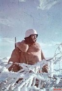 German infantry soldier as in winter outfit performing his duty as a sentry in the freezing cold of Russian winter, 1941/42. He is wearing sheepskin coat, warm enough for his demanding job.