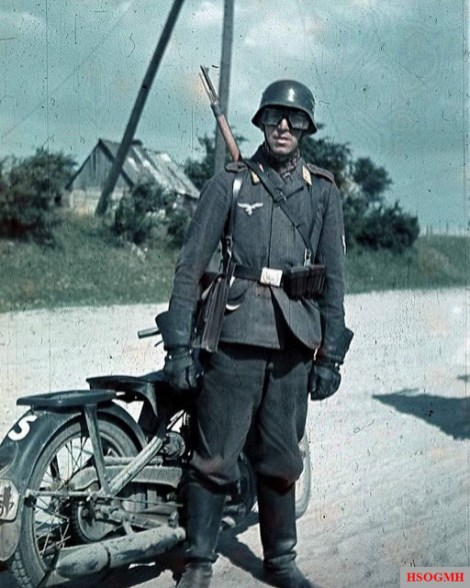 Dispatch rider from a Luftwaffe Field Division stands next to his DKW NZ250 krad, and note the early all leather motorcyclist glove.