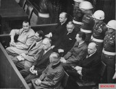 Göring (first row, far left) at the Nuremberg Trial.