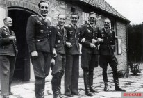 The commanders of NJG 1 (Nachtjagdgeschwader 1). From left to right: Hauptmann Heinz-Wolfgang Schnaufer, Hauptmann Martin Drewes, Major Hans-Joachim Jabs, Hauptmann Paul Förster, and Hauptmann Eckart-Wilhelm von Bonin. The picture was taken in the Summer of 1944 at Fliegerhorst Leeuwarden, Netherlands.