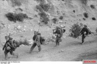 German soldiers marching in the harsh rocky terrain of the Atlas ridges.