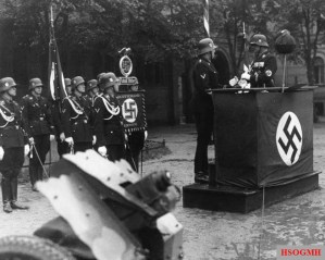 Parade for the third anniversary of the LSSAH on the barracks' grounds. Sepp Dietrich is at the lectern. May 1935.