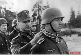 Generalleutnant Johann Sinnhuber (Kommandeur 28. Jäger-Division) decorates Oberjäger Walter Möse Knight's Cross with the Iron Crosses for his exceptional bravery in the battle at Lake Ladoga area. The picture was taken by Kriegsberichter Ebert on 11 March 1943.