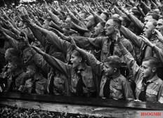 Hitler Youth saluting.