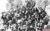 Men of US 64th Regiment, 7th Infantry Division, celebrate the news of the Armistice, 11 November 1918.