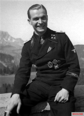 "Smiling SS-Sturmbannführer Max Wünsche (Kommandeur I.Abteilung / SS-Panzer-Regiment 1 / SS-Panzergrenadier-Division ""Leibstandarte SS Adolf Hitler"") photographed at Berghof, in the Obersalzberg of the Bavarian Alps, Germany, in the spring of 1943."