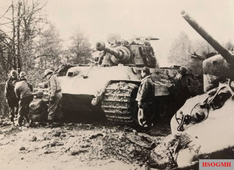 Allied troops inspect a Tiger II next to a Panther.