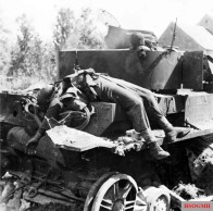 A knocked-out German PzKpfw IV tank with the burnt bodies of two of its crew in the Falaise Pocket, 24 August 1944.