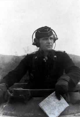 Hauptmann der Reserve Walter Scherf, the commander of 3.Kompanie / schwere Panzer-Abteilung 503, in his Tiger tank in Normandy, 1944.