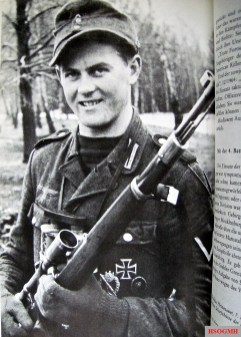 Hetzenauer with the Mauser K98k sniper rifle carabiner with a 6x Zeiss ZF42 rifle scope.