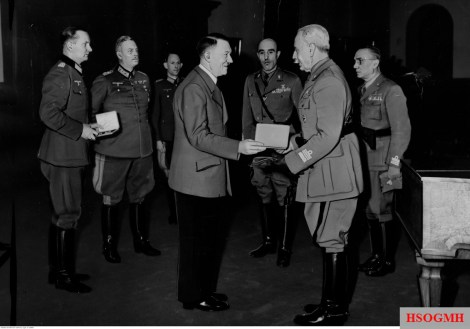 5 April 1943: From left to right: Oberstleutnant Gerhard Engel, Generalfeldmarschall Wilhelm Keitel, Generalleutnant Rudolf Schmundt, Adolf Hitler, Generale di Brigata Efisio Marras , Generale d'Armata Italo Gariboldi - Commander Italian Army in Russia, and unknown Italian Generale di Divizione. The picture was taken by Presse-Hoffmann photographer at the Ritterkreuz award ceremony for Gariboldi, held in Berghof Obersalzberg.