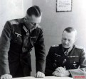 Two officers from the besieged German forces in Brest-Litovsk, Belarus discussing the strategy during Summer of 1944. From left to right: Hauptmann Bruno Bogert and Generalleutnant Walter Scheller.