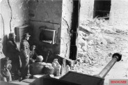 German soldiers stationed in the ruins of Cassino; the 75mm piece in the lower right foreground belongs to a StuG III assault cannon.