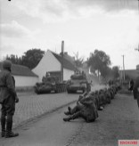 Cromwell and Stuart tanks of Guards Armoured Division passing German POWs during the advance to Brussels, 3 September 1944.