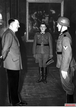 Adolf Hitler receives Obergefreiter Hubert Brinkforth from Schützen-Regiment 25 /12.Panzer-Division in the Reichskanzlei, Berlin, 5 April 1941. Brinkforth is most notable for being the first enlisted man to be awarded the Ritterkreuz des Eisernen Kreuzes (Knight's Cross of the Iron Cross).