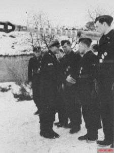 """On 14 January 1944, panzer ace Michael Wittmann was awarded the Ritterkreuz des Eisernen Kreuzes (Knight's Cross of the Iron Cross) along with his gunner, Bobby Woll, for their achievements which have so far destroyed 88 enemy tanks. The presentation was made at Vinnytsia, Ukraine, by his divisional commander SS-Oberführer Theodor """"Teddy"""" Wisch, who also nominated him for the Eichenlaub to his Ritterkreuz."""