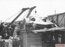 Loading the hull of the H IX V3 for transportation to the United States, August 1945.