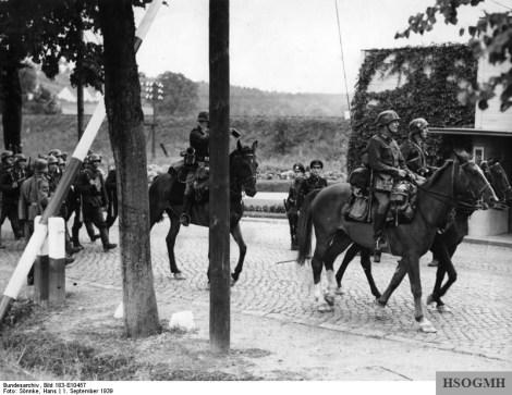 Poland, 1939. German horsemen cross the Polish border.