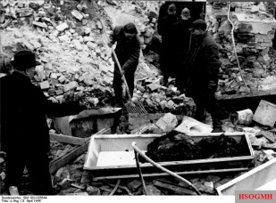 Recovering charred corpses from underground bunkers following a bombing raid on Berlin, 1944.